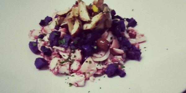 Polpo, olive taggiasche, carciofi, patate violetta